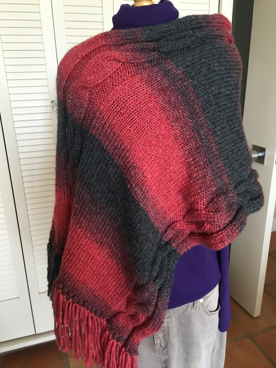 Shaded red to charcoal poncho with cable design