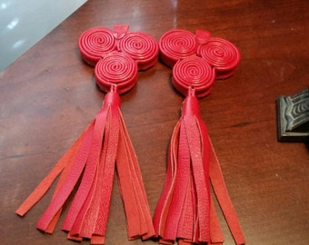 Leather earrings tri-spiraled with tassels/fringe.