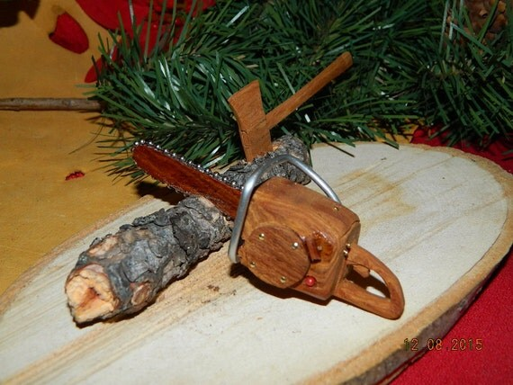 Miniature chainsaw with mountain man axe and pine log wood