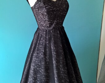 Original vintage 1950s black lace dress with pink lining