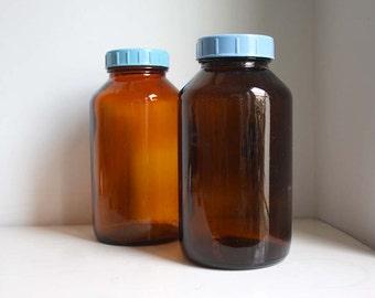 Soviet Vintage Large Apothecary Jars. One Litre. Orange-Brown with Light Blue Lids.