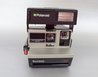 Polaroid Sun 600 Instant Camera- Check us out and all of our amazing Polaroid cameras