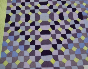 Quilt: bow tie in plain purple, yellow and blue cotton and synthetic fabrics   hand quilted  1970's