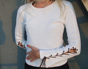 White top with wide sleeve and lacing