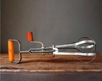 Vintage amber bakelite hand mixer, Ekco stainless steel hand mixer