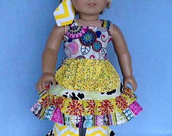 18 inch doll or American Girl doll ruffled dress, ruffled pants, and head scarf.  Vibrant prints.