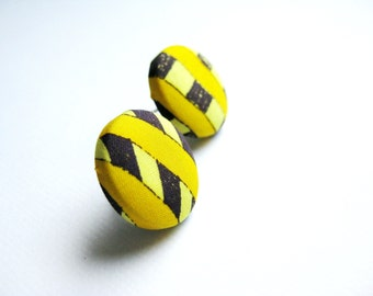 Fabric covered button earrings in dark purple and yellow, striped pattern