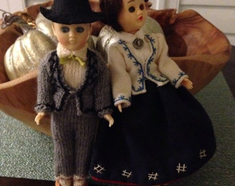Pair of plastic dolls with moving eyes and handmade clothes vintage pair