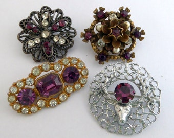 Collection of four vintage rhinestone brooches in purple