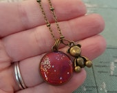 One of a kind bronze HubbleBubble charm necklace in berry tones with teddy charm