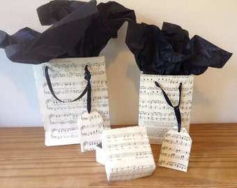 Gift bags and box made from recycled vintage sheet music