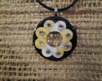 Small 1 1/4 inch metal washer necklace - Black with yellow pattern and rhinestones.