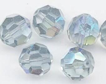 "Twelve ""out of program""  Swarovski crystals - Art. 5000 - 8 mm - indian sapphire AB"