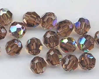 Twelve Swarovski crystals - Art. 5000 - 8 mm - reprise of discontinued color colorado topaz AB