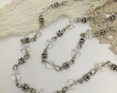 19.5 inches of antique silver and clear glass bicone beaded chain