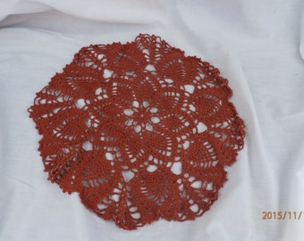 rust colored doily