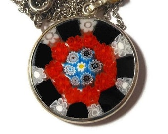 Millefiori glass pendant, 25mm round red, black, blue, yellow white disc on sterling silver chain marked 925 Italy on bail, 925 on clasp