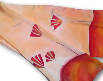Hand painted silk scarf with flowers in clay and bric reds. Orange, red.