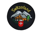 """Swiss Alps Cabin """"Switzerland"""" Patch Country Vacation Souvenir Iron-On Applique"""