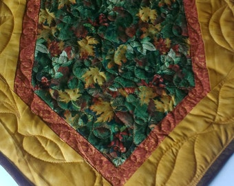 Handmade quilted fall table runner with fall leaves in autumn colors