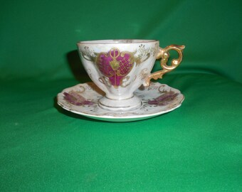 One (1), Footed, Iridescent Tea Cup & Saucer, from Royal Sealy, in the RSY 35R Pattern.