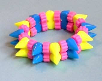 Neon Yellow and Blue Spike Stretch Bracelet with Pink Beads
