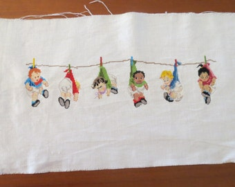 Vtg Micro Needlepoint. Babies in Diapers Hanging by clothespins from clothes-line.