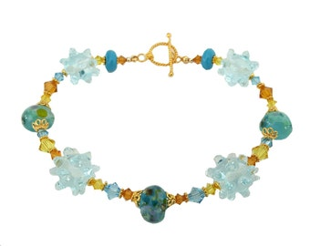 blue and Gold Lampwork Bead Bracelet, pale blue bumpy lampwork beads, and Swarovski crystals, Vermeil Gold clasp
