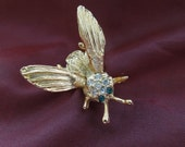 Vintage Bee Brooch, Gold Tone with Clear and Green Rhinestones.  Wings Move.  Bumble Bee