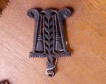 Cast Iron Trivet with Tassels Design