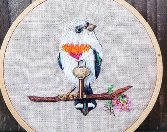 Little gray bird with key embroidered hoop art by bannerandsail