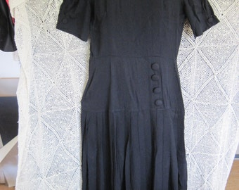 On Sale:Very wearable 1950's navy crepe dress