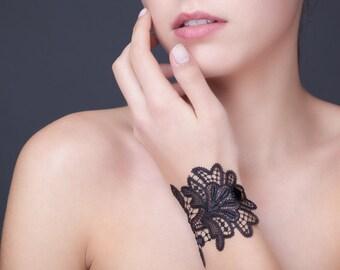 Black lace bracelet with a crystal button of Swarovski