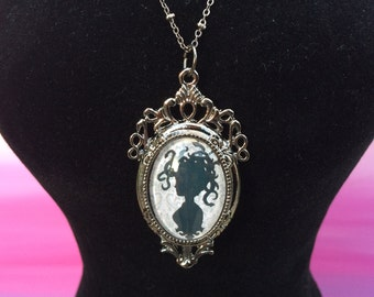 Medusa silhouette art print in a pendant necklace
