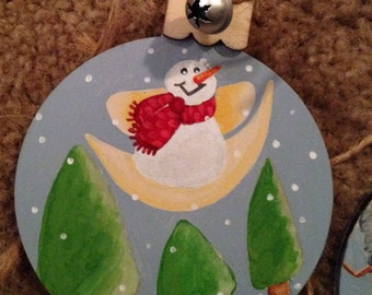 Christmas ornaments dancing snowmen silver bells and twine