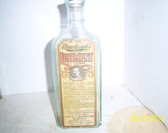 1920's Rawleighs Liniment Freeport, ILL 8 1/2  inch tall aqua medicine bottle with paper label