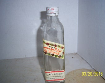 1960's ARAK Raisin Israel Liquor Whiskey Bottle 6 5/8  inches tall with label