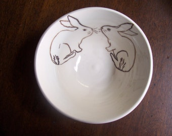 2 rabbits in a bowl