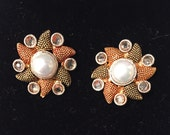 Starfish studs on sale. Available in pink and green stone