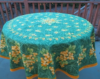 Round 100% cotton tablecloth.70'' diameter. Fabric from Provence, France.Grapes in green.