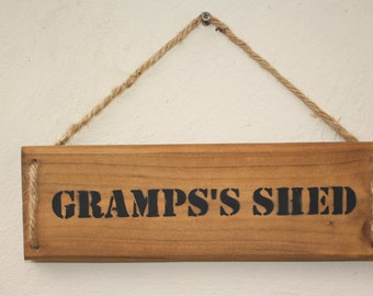 Wall Plaque - Gramps's Shed, handmade from recycled or fsc timber, stained in a mid oak weatherproof stain with a 4 ply jute hanger