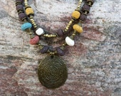 Triple Strand Blue Brown Mustard Ivory Burnt Red Lava Bead Necklace with Chunky Spiral Antique Brass Oval Pendant  Spacers Caps Beads Cones
