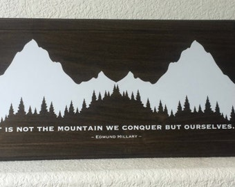 It is not the mountain we conquer but ourselves. Edmund Hillary - Handmade in USA Lodge Cabin home -  Solid wood plaque sign. 22x11