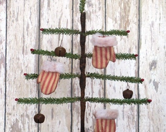 Primitive Faux German Single Feather Tree with rusty star and red pips and red an white ticking mittens