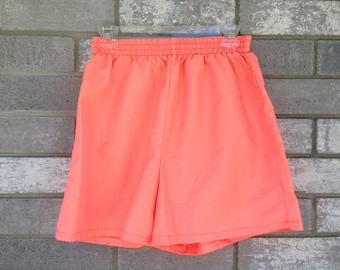90s neon shiny orange surf shorts