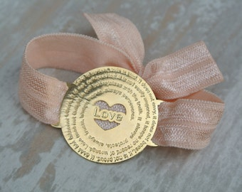 Love is... elastic bracelet, gold tone