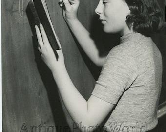 School teacher w chalk by black board vintage art photo