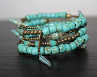 Bracelet in the ethno style elements with bronze and turquoise