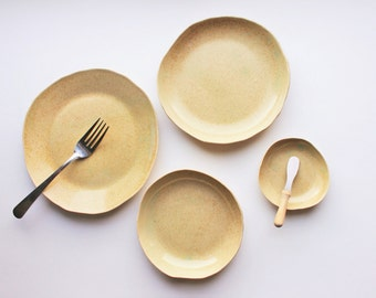Set of four handmade ceramic speckled serving plates