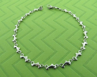 stainless steel dolphin chain anklet. avail in 9 and 10 inches